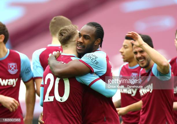 Michail Antonio of West Ham United celebrates scoring his teams first goal during the Premier League match between West Ham United and Tottenham...