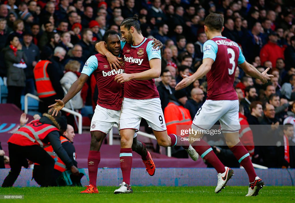 Michail Antonio (L) of West Ham United celebrates scoring his team's first goal with his team mates Andy Carroll (C) and Aaron Cresswell (R) during the Barclays Premier League match between West Ham United and Liverpool at Boleyn Ground on January 2, 2016 in London, England.