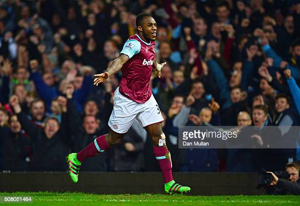 Michail Antonio of West Ham United celebrates scoring his team's first goal during the Barclays Premier League match between West Ham United and...