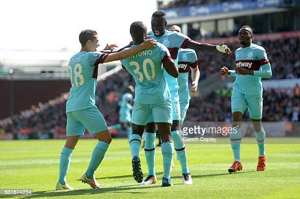 Michail Antonio of West Ham United celebrates scoring his team's first goal with his team mates during the Barclays Premier League match between...
