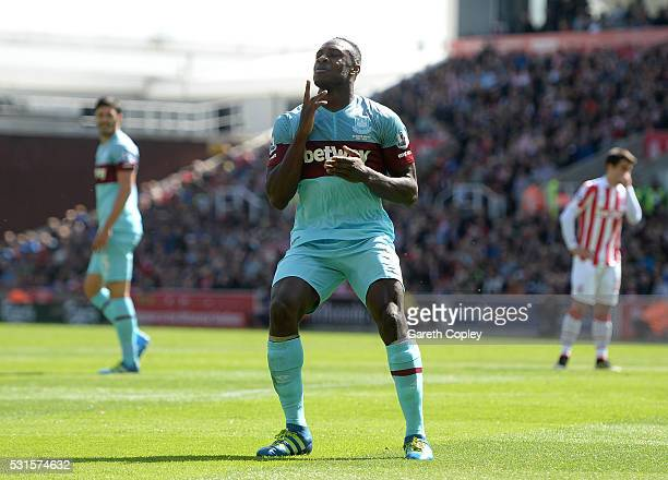 Michail Antonio of West Ham United celebrates scoring his team's first goal during the Barclays Premier League match between Stoke City and West Ham...