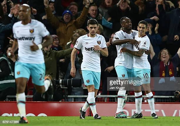 Michail Antonio of West Ham United celebrates scoring his team's second goal with his team mates Manuel Lanzini during the Premier League match...
