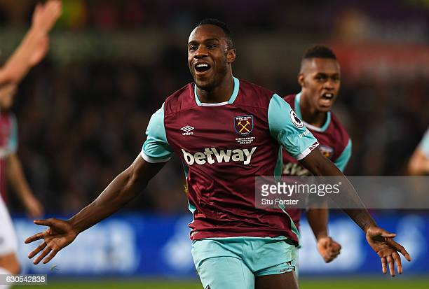 Michail Antonio of West Ham United celebrates scoring his team's third goal during the Premier League match between Swansea City and West Ham United...