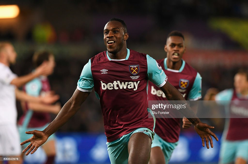 Michail Antonio of West Ham United celebrates scoring his team's third goal during the Premier League match between Swansea City and West Ham United at Liberty Stadium on December 26, 2016 in Swansea, Wales.