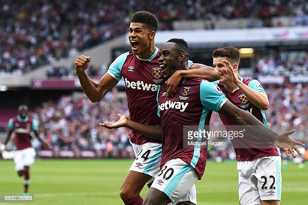 Michail Antonio of West Ham United celebrates scoring the opening goal with team mate Ashley Fletcher during the Premier League match between West...