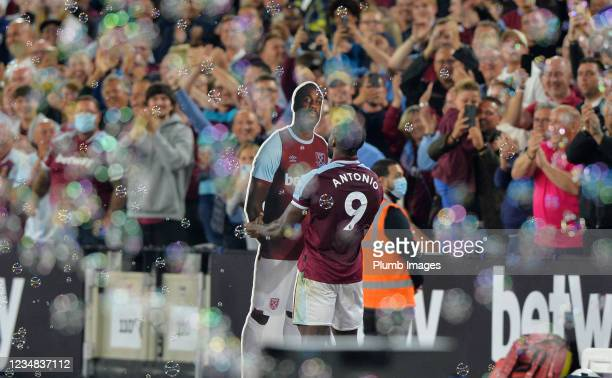 Michail Antonio of West Ham United celebrates with a cardboard cut out of himself after scoring to make it 4-1 during the Premier League match...