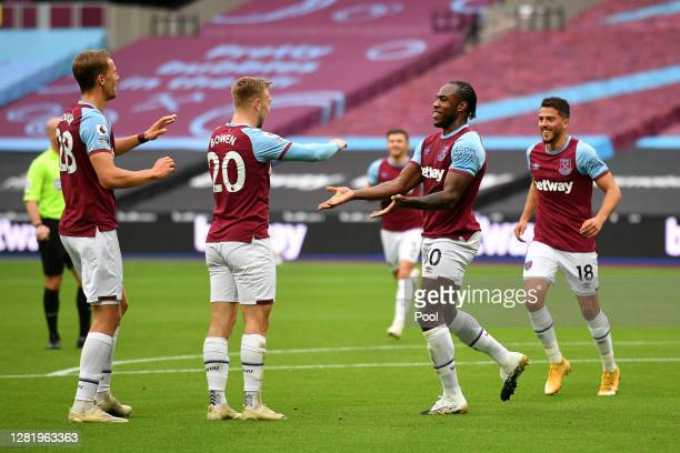 Michail Antonio of West Ham United celebrates with his team after scoring his team's first goal during the Premier League match between West Ham...