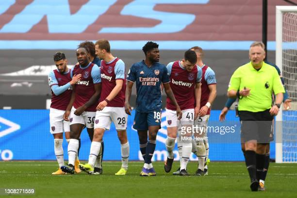 Michail Antonio of West Ham United celebrates with Said Benrahma and Tomas Soucek after scoring their side's third goal during the Premier League...