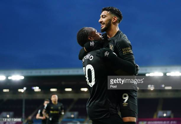 Michail Antonio of West Ham United celebrates with Said Benrahma after scoring their side's second goal during the Premier League match between...