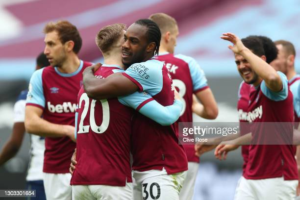 Michail Antonio of West Ham United celebrates with team mate Jarrod Bowen after scoring their side's first goal during the Premier League match...