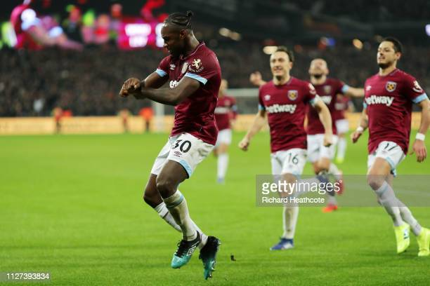 Michail Antonio of West Ham United celebrates with team mates after scoring his team's first goal during the Premier League match between West Ham...