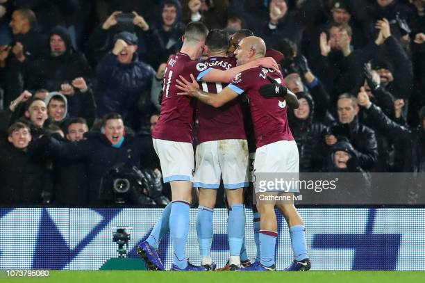 Michail Antonio of West Ham United celebrates with teammates after scoring his team's second goal during the Premier League match between Fulham FC...