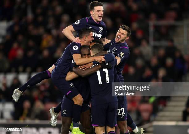 Michail Antonio of West Ham United celebrates with teammates after scoring his team's second goal, which is later ruled out by VAR during the Premier...