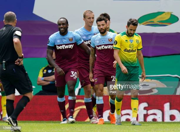 Michail Antonio of West Ham United celebrates with teammates after scoring his team's fourth goal during the Premier League match between Norwich...