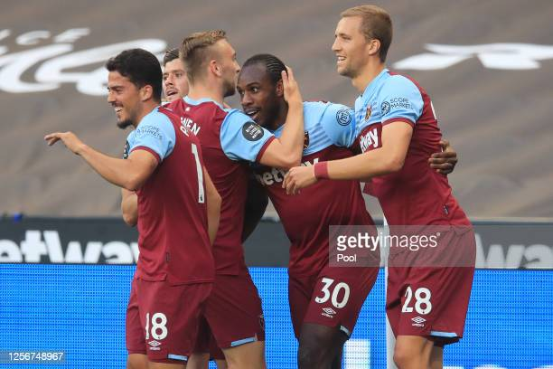 Michail Antonio of West Ham United celebrates with teammates after scoring his team's first goal during the Premier League match between West Ham...