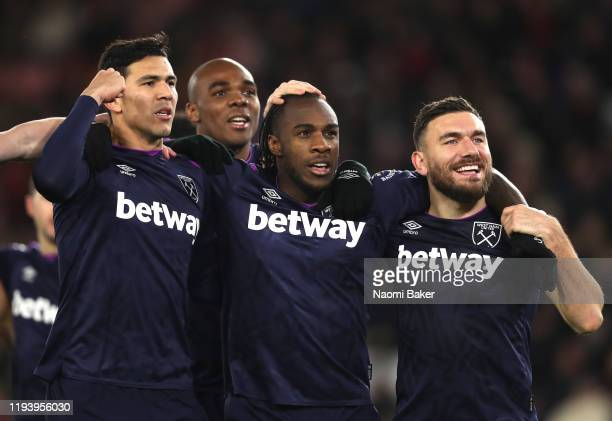 Michail Antonio of West Ham United celebrates with teammates Fabian Balbuena and Robert Snodgrass after scoring his team's second goal which is later...