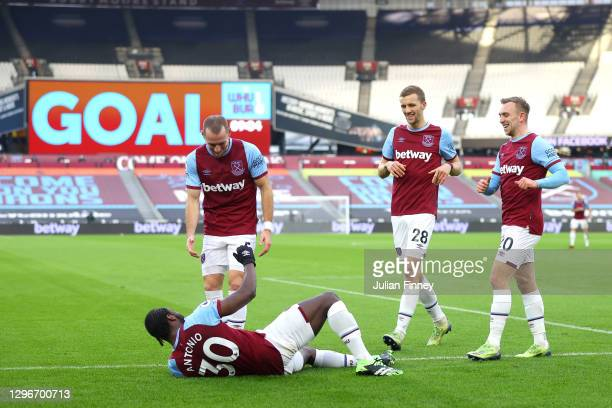 Michail Antonio of West Ham United celebrates with teammates Vladimir Coufal, Tomas Soucek and Jarrod Bowen after scoring his team's first goal...