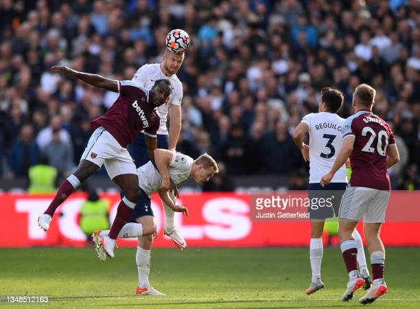 Michail Antonio of West Ham United competes for a header with Eric Dier and Oliver Skipp of Tottenham Hotspur during the Premier League match between...