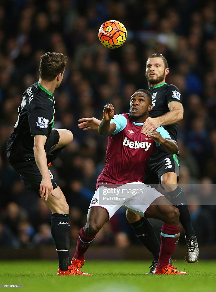 Michail Antonio (C) of West Ham United competes for the ball against Marco van Ginkel (L) and Erik Pieters (R) of Stoke City during the Barclays Premier League match between West Ham United and Stoke City at the Boleyn Ground on December 12, 2015 in London, United Kingdom.