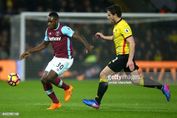 Michail Antonio of West Ham United evades Daryl Janmaat of Watford during the Premier League match between Watford and West Ham United at Vicarage...