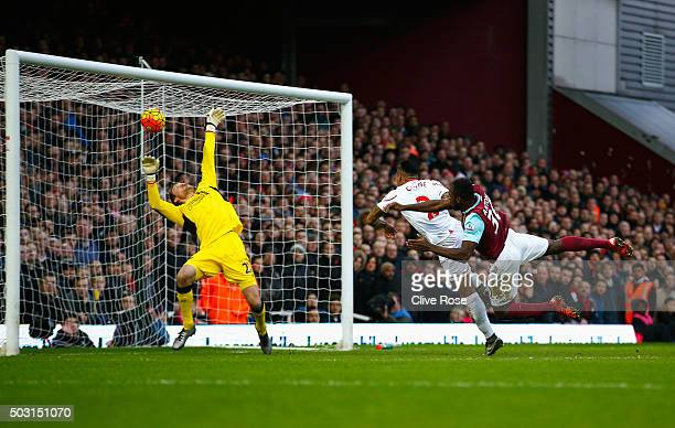 Michail Antonio of West Ham United heads the ball past Simon Mignolet of Liverpool to score his team's first goal during the Barclays Premier League...