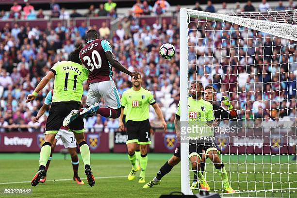 Michail Antonio of West Ham United heads the opening goal during the Premier League match between West Ham United and AFC Bournemouth at London...