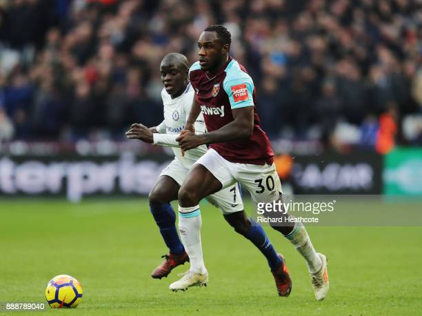 Michail Antonio of West Ham United is challenged by N'Golo Kante of Chelsea during the Premier League match between West Ham United and Chelsea at...