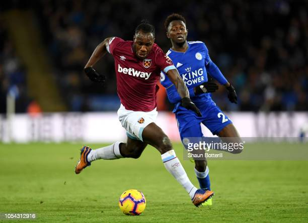 Michail Antonio of West Ham United is challenged by Onyinye Wilfred Ndidi of Leicester City during the Premier League match between Leicester City...