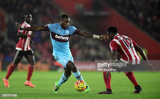 Michail Antonio of West Ham United is faced by Victor Wanyama of Southampton during the Barclays Premier League match between Southampton and West...