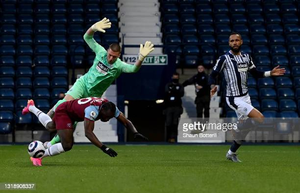 Michail Antonio of West Ham United is fouled by Sam Johnstone of West Bromwich Albion leading to a penalty during the Premier League match between...