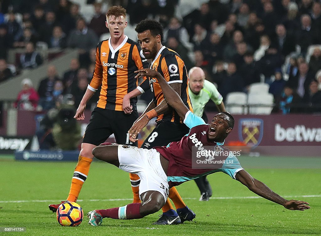 Michail Antonio of West Ham United is fouled in the penalty box by Tom Huddlestone of Hull City during the Premier League match between West Ham United and Hull City at London Stadium on December 17, 2016 in Stratford, England.