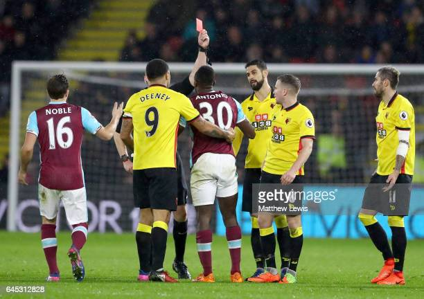 Michail Antonio of West Ham United is shown a red card during the Premier League match between Watford and West Ham United at Vicarage Road on...