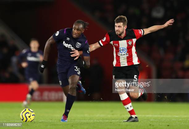 Michail Antonio of West Ham United runs with the ball from Jack Stephens of Southampton during the Premier League match between Southampton FC and...