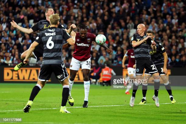 Michail Antonio of West Ham United scores his team's first goal during the Carabao Cup Third Round match between West Ham United and Macclesfield...