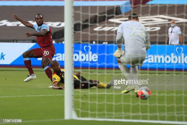 Michail Antonio of West Ham United scores his team's first goal during the Premier League match between West Ham United and Watford FC at London...