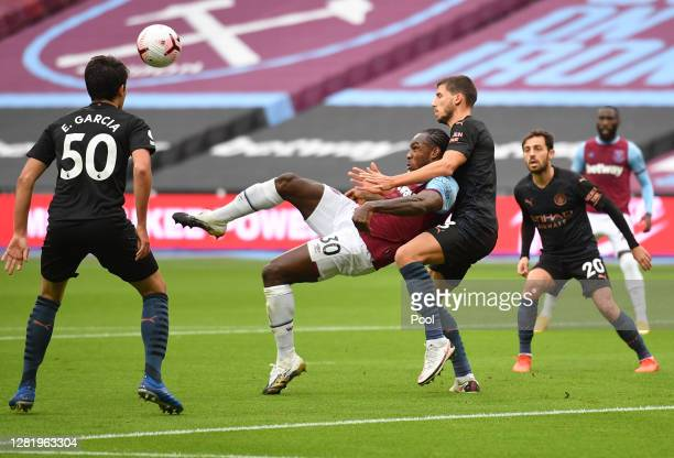 Michail Antonio of West Ham United scores his team's first goal during the Premier League match between West Ham United and Manchester City at London...