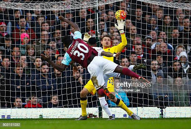 Michail Antonio of West Ham United scores his team's first goal during the Barclays Premier League match between West Ham United and Liverpool at...