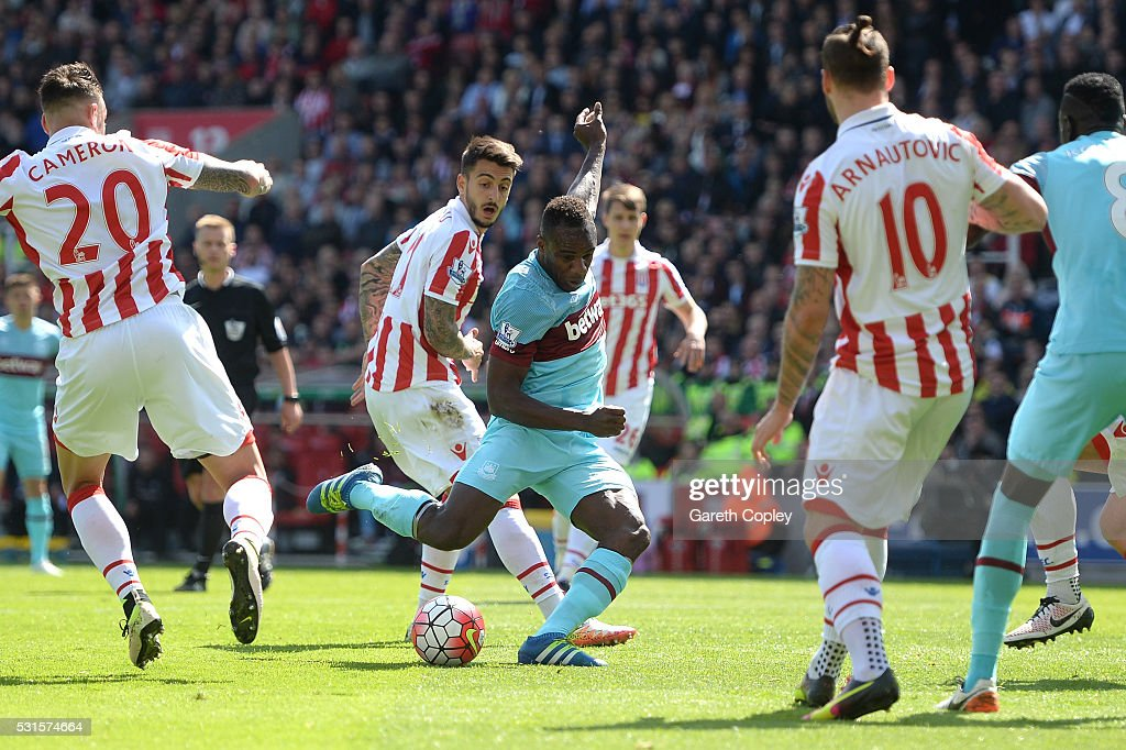 Michail Antonio of West Ham United scores his team's first goal during the Barclays Premier League match between Stoke City and West Ham United at the Britannia Stadium on May 15, 2016 in Stoke on Trent, England.
