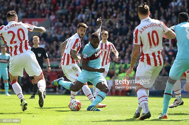 Michail Antonio of West Ham United scores his team's first goal during the Barclays Premier League match between Stoke City and West Ham United at...