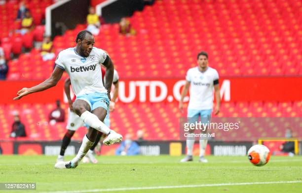 Michail Antonio of West Ham United scores his team's first goal from a penalty during the Premier League match between Manchester United and West Ham...