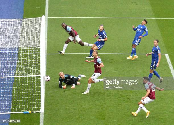 Michail Antonio of West Ham United scores his team's first goal past Kasper Schmeichel of Leicester City during the Premier League match between...