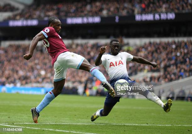 Michail Antonio of West Ham United scores his team's first goal under pressure from Davinson Sanchez of Tottenham Hotspur during the Premier League...