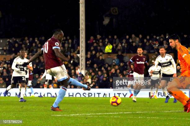 Michail Antonio of West Ham United scores his team's second goal past Sergio Rico of Fulham during the Premier League match between Fulham FC and...