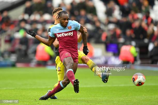 Michail Antonio of West Ham United scores his team's third goal during the Premier League match between West Ham United and Southampton FC at London...