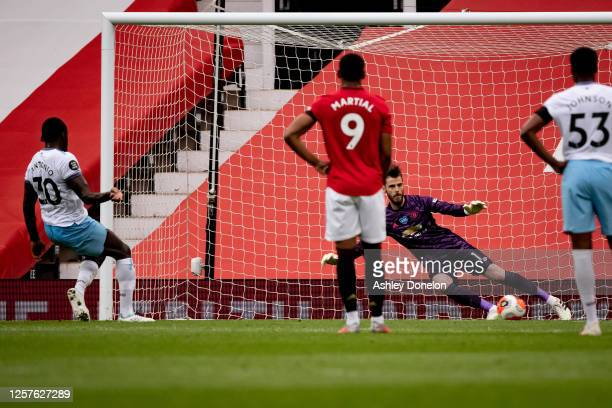 Michail Antonio of West Ham United scores their first goal during the Premier League match between Manchester United and West Ham United at Old...
