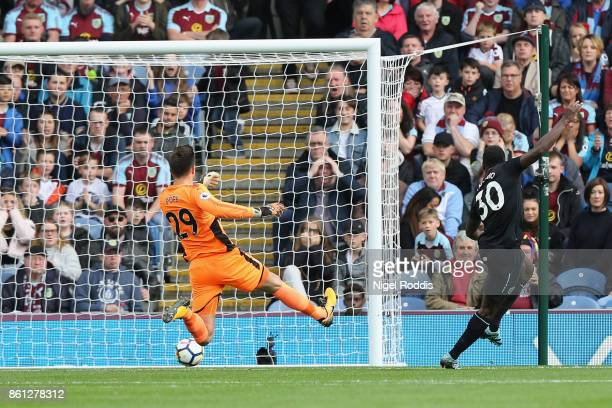 Michail Antonio of West Ham United scores their first goal past Nick Pope of Burnley during the Premier League match between Burnley and West Ham...