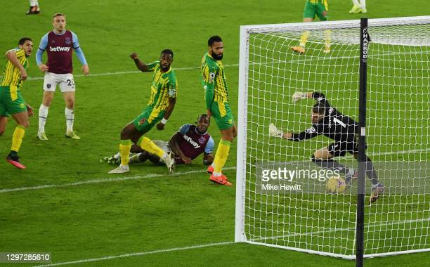 Michail Antonio of West Ham United scores their sides second goal past Sam Johnstone of West Bromwich Albion during the Premier League match between...