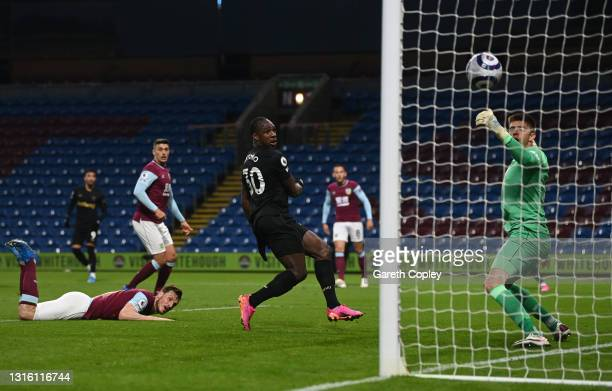 Michail Antonio of West Ham United scores their side's second goal past Nick Pope of Burnley during the Premier League match between Burnley and West...