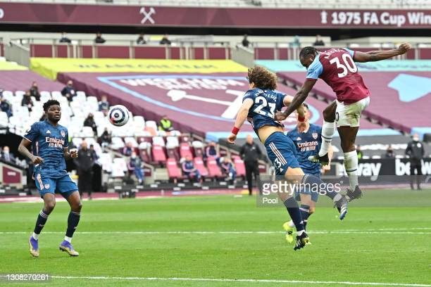 Michail Antonio of West Ham United shoots before Tomas Soucek of West Ham United scores their side's third goal during the Premier League match...