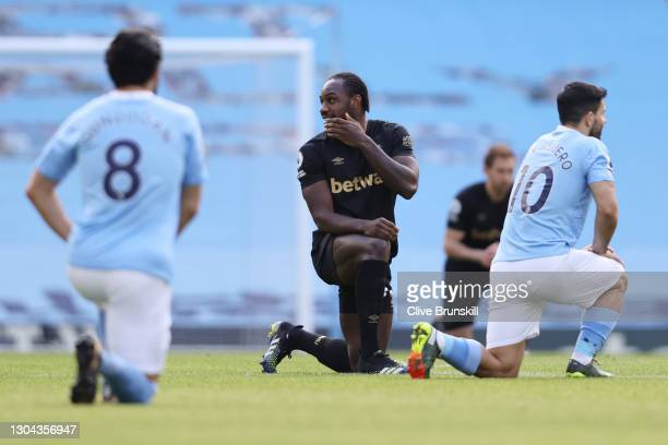 Michail Antonio of West Ham United takes a knee in support of the Black Lives Matter Movement prior to during the Premier League match between...